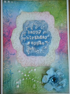 Background blended and stamped and flower inked with Distress Inks